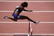 Muhammad bate su récord mundial de 400 m vallas con 52.16